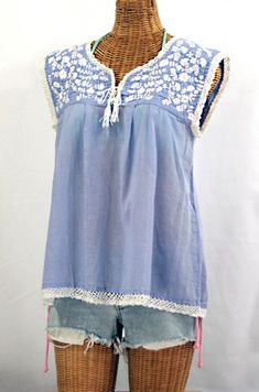 "Super cute! Siren's ""La Marbrisa"" Embroidered Sleeveless Peasant Blouse in Periwinkle with White Embroidery.  Hand embroidered, dyed, crocheted and distressed for a retro-vintage vibe.  $48.95"