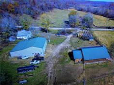 Beautiful Secluded 600+ Acre Cattle Farm!! Fenced and crossed fenced with plenty of live water springs & creeks and about 350 acres of pasture & beautiful wooded land for trophy bucks and turkeys. Very comfortable log sided home with 2376 Sq. Ft. of living space. Home is about 10 years new. Wood insert fireplace for cozy winter days- heat pump system too. 4 bd , 2 bath, large living room, and custom cabinetry in kitchen. Breath-taking views to be enjoyed from the wrap around covered deck…
