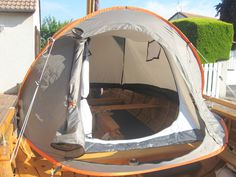 A nice view of the Quechua Decathlon pop up tent with cut out floor on Gérard Quillet's 13 1/2' Leecton.  Quillet notes that since the tent fits inboard of the gunwales, rainwater still collects in the bilges.