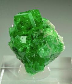 Tsavorite from Tanzania. Incredible deep green tsavorite garnets on graphite matrix. The crystals have a fantastic green color that are gemmy and clear. Plus, all the edges show nicely bevelled faces.