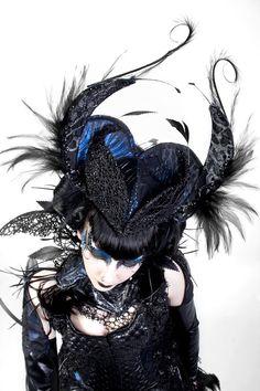 Black feather, Swarovski Crystal headband/ headpiece with blue/black fabric.. $450.00, via Etsy.