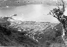 A Samoan village, now occupied by Marines defending the Island of Tutuila. The lumber, supplies and warehouses indicated the possibility of a huge fueling base for Naval Ships in the making along Pago Pago harbor. Am. Samoa - October 1942
