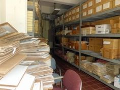 """Archivists try to care for the homes of archives. """"...inside the Enid M. Baa Library in Charlotte Amalie, St. Thomas. The conditions in the building aren't ideal for archives."""""""