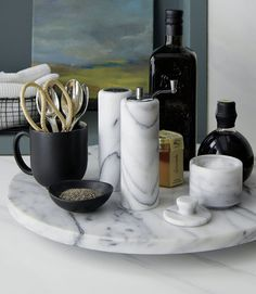 Put your salt and pepper into marble shakers and keep them on a lazy suzan or tray to create the ultimate marble kitchen table centerpiece.