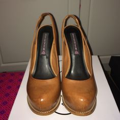 Steven by Steve Madden These leather luggage tan colored sling backs have a 5 1/4 inch heel with 1 1/2 inch platform built in the front. Black snake skin leather covers the heel. Worn once. They're in pristine condition. Steve Madden Shoes