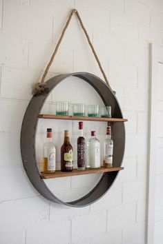 """Circle Iron & Wood Hanging Shelf Distinctive home & garden decorative accessories and accents. Dimensions:36""""""""d x 7"""""""" deep Usually ships within 3 Business Days Please be aware that some products are h"""