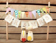 Custom Wooden Bride and Groom Wedding Couple for Gift or Cake Topper. £25.00, via Etsy.