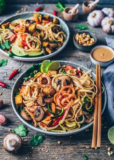 This Vegan Pad Thai with crispy tofu, rainbow vegetable noodles, and creamy peanut sauce is quick and easy to make, healthy and so delicious! #vegan #glutenfree