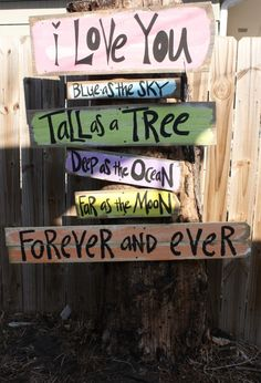 scroll to the bottom for this adorable backyard sign DIY...soooo cute!