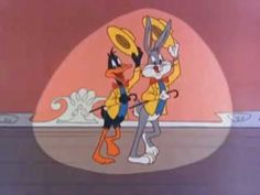 """Overture, curtain, lights..."" ""This is It,"" written by Mack David and Jerry Livingston, the opening theme song for ""The Bugs Bunny and Roadrunner Hour."""