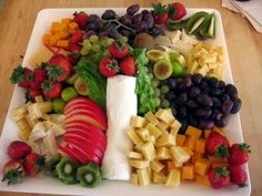 Colorful fruit and cheese platter