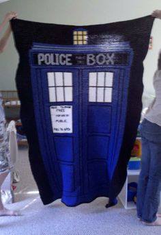 She crocheted this TARDIS blanket for her son who loves Doctor Who... It will fit a twin size bed....was fun but lots of work!