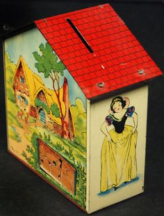 1950s tin Snow White (house) tin bank with the little keyed door to retrieve your money