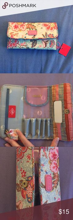 NWT Oilily Brush Clutch! 👛 Adorable makeup brush carrier that looks like a clutch! 5 brush slots, plus a zippered pouch and mirror. Snap closure. New with tags! Oilily Bags Cosmetic Bags & Cases