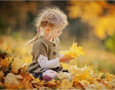 This is like me as a little girl (and now too). Love the fall leaves!