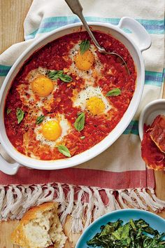 Stewed Tomato Shirred Eggs with Ham Chips - 50 Top Rated  Recipes of 2016 - Southernliving. Recipe: Stewed Tomato Shirred Eggs with Ham Chips  Our crunchy ham chips might become your go-to topper for all breakfast fare.