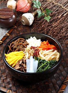 Bibimbap (Korean) - rice, meat, vegetables, with an optional fried egg on top. Comes with a dish of spicy sauce to mix in.  An array of small dishes of pickled vegetables also served. Delicious!