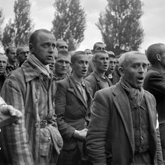 """French prisoners sing the national anthem, """"La Marseillaise,"""" upon the liberation of the Nazi concentration camp of Dachau, near Munich, by Allied troops, April 18, 1945."""