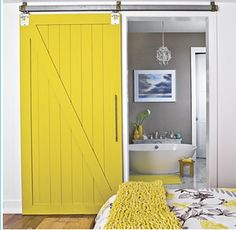 Gray walls in the bathroom with a golden yellow... nice.