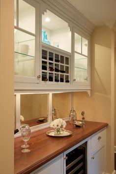 Mirrored back, paint white, wine refrigerator.  House of Turquoise: Dalia Canora Design