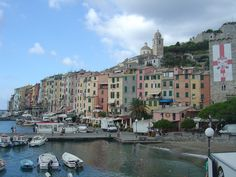 The quayside at the rather charming Italian town of La Spezia in Liguria. Notice the flags of St. George outside the windows of buildings. Surely they can't be England supporters can they? ;)