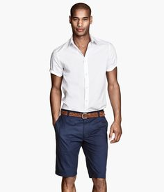 Crisp half sleeve white button down and navy chino shorts