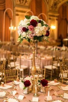 Tall Wedding Centerpieces filled in with red and white flowers | affordable wedding centerpieces #weddingcenterpieces