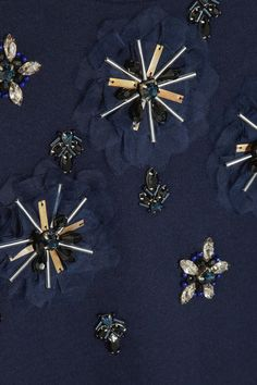 Navy cotton-jersey Black, blue and clear crystals, blue and silver beads, metallic embellishments, voile flower appliqués, ribbed trims Slips on 80% cotton, 10% resin, 5% metal, 5% silk Dry clean
