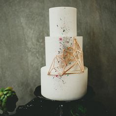modern geometric wedding cake with 3-D accent and paint splatters