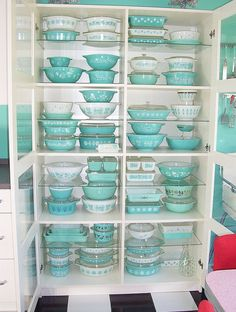 vintage aqua Pyrex - I had those solid aqua bowls! (3rd shelf from bottom-left) - still have the smallest one...