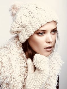 ea52163acda Chunky knit mittens   cable-knit hat with faux fur pom-pom.