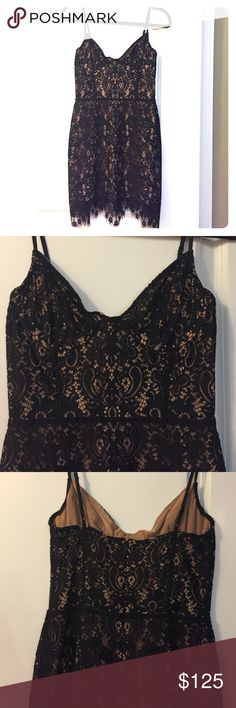 For Love and Lemons Vika Lace Dress Adorable black lace mini dress with nude underlay. Only worn twice! No bra needed thanks to built in boning. Perfect outfit for a night out! For Love and Lemons Dresses Mini