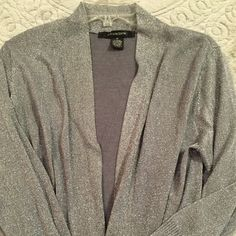 Silver throw sweater Silver shimmery throw over sweater. Never worn. Is a 1x but fights more like a medium-large 89th & Madison Sweaters Shrugs & Ponchos