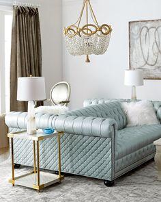 Tufted blue sofas