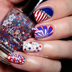 Add sparkle to your Fourth of July theme with a white, red and blue flower patterned water marble nail art design.