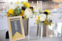 Table Numbers + Whimsical Centerpieces | Yellow and Gray Wedding Colors | Paperwhites Photography  Read More: http://stylemepretty.com/2013/06/27/los-angeles-wedding-from-paperwhites-photography/