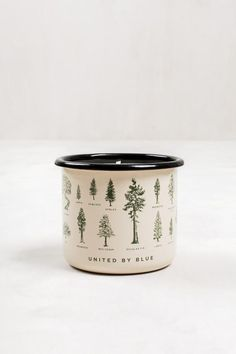 Pine-scented, hand poured soy candle with subtle hints of vanilla. Enamel steel mug features evergreen tree design and can be used once candle burns through.