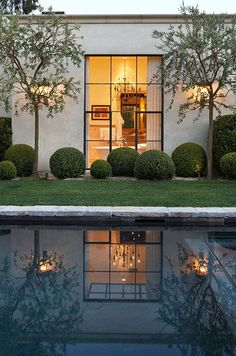 garden pool exterior, attributed to Scott Shrader. I love the asymmetrical placement of the boxwoods, and the way in which the trees and steel window reflect in the pool.Top pinned images of January 2014 Houses Architecture, Architecture Design, Exterior Design, Interior And Exterior, Outdoor Spaces, Outdoor Living, Garden Pool, Garden Landscaping, Future House