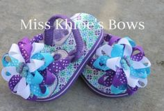 boutique style flip flops.. hmm totally digging flip flops with bows  to go with a birthday tutu for mariah:) Turquoise Butterfly Bow Flip Flops so cute.