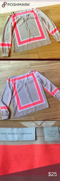"New York & Co Multi Color Blouse Excellent condition New York and Co tan and pink blouse with tassels. Dimensions: Length 24 1/4"" Bust 40"" Sleeve Length 23 1/2"" New York & Company Tops Blouses"