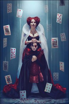 Alice in Wonderland, the Queen of Hearts and her King