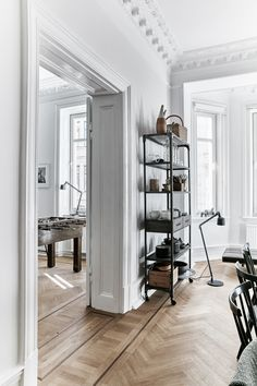 French-style apartment, herringbone floors, Vipp lamps and natural light in a modern home of 4 in Gothenburg, Sweden