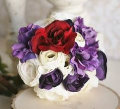 red, purple, and white wedding bouquet