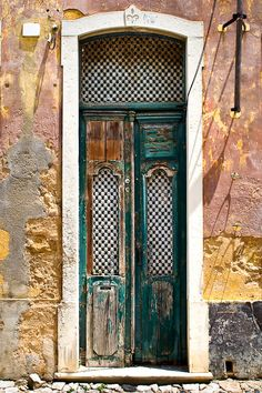 Run down but beautiful old houses. Chipped paint, amazing doors and great façade.