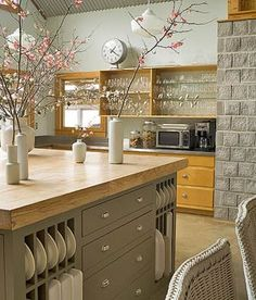 love the texture in this kitchen - butcher black counter tops, open shelving, stone wall, and branches. : kitchen design