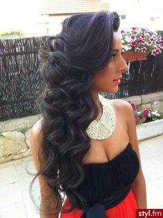Classy and sassy look black hair and long waves on the side.