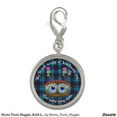 Hoots Toots Haggis, Auld Lang Syne Photo Charm  Hoots Toots Haggis is the friendliest wee haggis ever to roam the Scottish hillsides. He grows heather and thistles on his back to blend in as he can be verra shy. However, with a wee bit of coaxing with a tattle scone, he'll soon quite happily let you clap or tickle him. A sweet design for any ex-pat Scot, or anyone who loves the Scottish culture!
