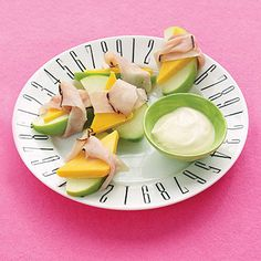 Don't underestimate this simple snack, which wraps together three lunch box staples for an after-school boost that will sustain kids until dinner. You might even want to grab one to stay full and focused. Recipe: Ham-and-Apple Wraps with Dip   - Delish.com