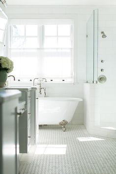 Penny tile and claw foot tub.