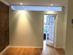 Custom room divider with plexiglass transom and French door. Call us for all your custom room partition inquiries. (646) 837-7300 #temporarywalls #roompartition #roomdividers #nyclife #NYC